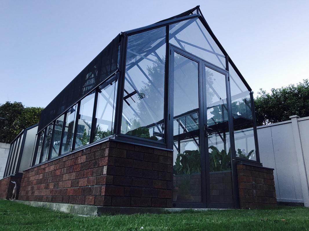 Elite Glasshouses with Stonewall Foundation - The Glasshouse